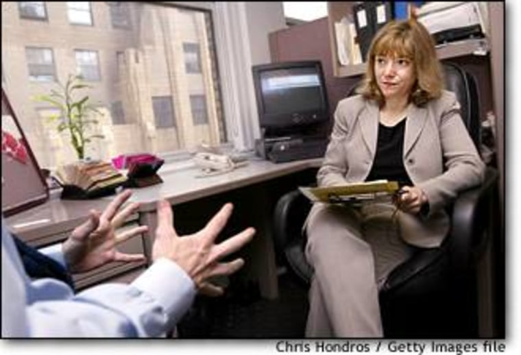 A job applicant speaks with recruiter Renee Chandler during an interview in May at the offices of Metro Support Group in New York City. The U.S. unemployment rate hit a nine-year high in June.