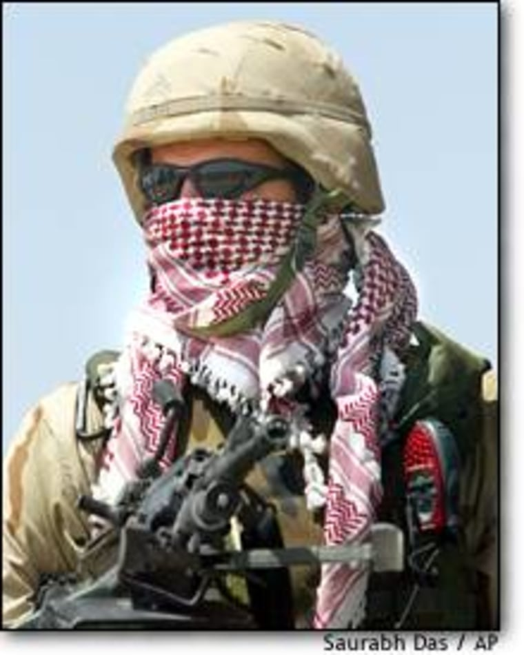 A U.S. soldier wears a traditional Arab scarf to protect himself from hot wind in Fallujah, west of Baghdad.