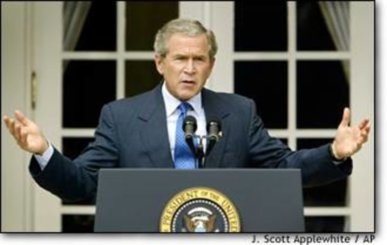 President Bush responds to a reporter's question during a news conference in the Rose Garden at the White House.