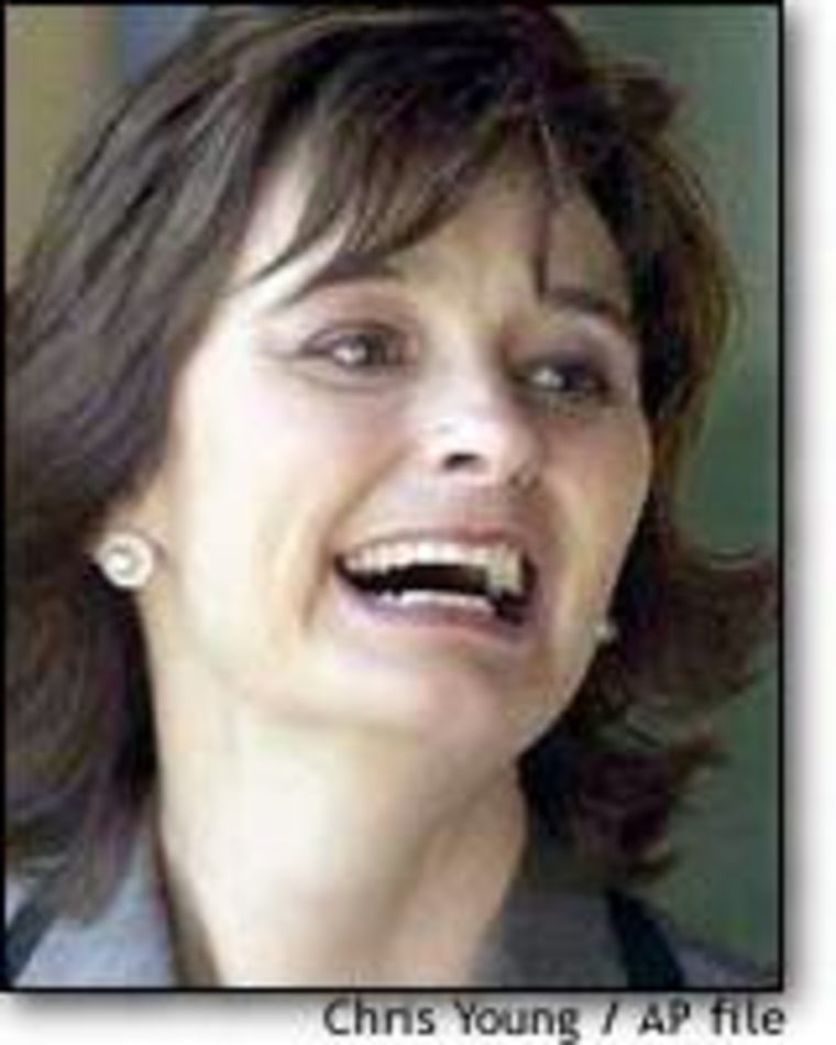 Cherie Blair, wife of British Prime Minister Tony Blair, has been criticized for allowing a photographer into the private quarters of Downing Street.