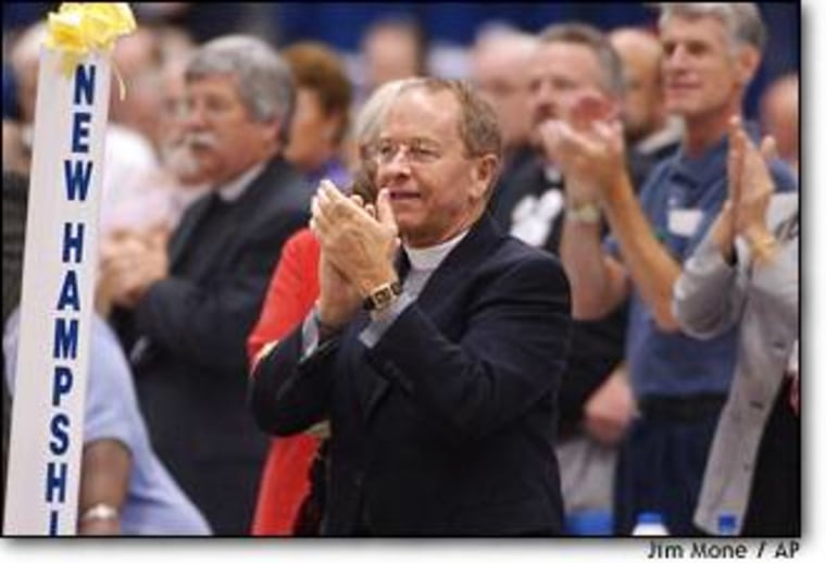 The Rev. V. Gene Robinson applauds at the Episcopal General Convention in August before a vote on whether to elect Robinson, a homosexual, as bishop of New Hampshire.