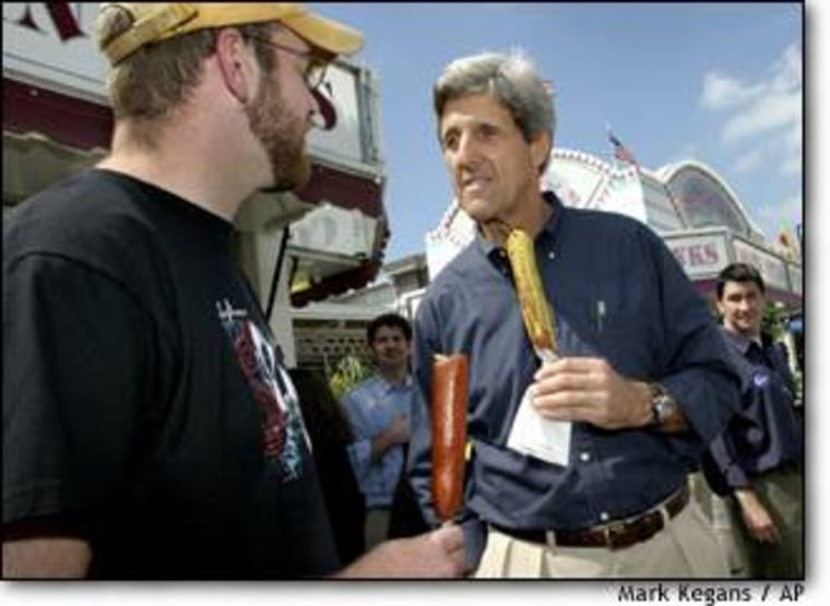 Presidential hopeful John Kerry visits over corndogs with Devon Silk at the Iowa State Fair in Des Moines.