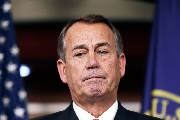 John Boehner answers questions during a press conference, Dec. 12, 2013.