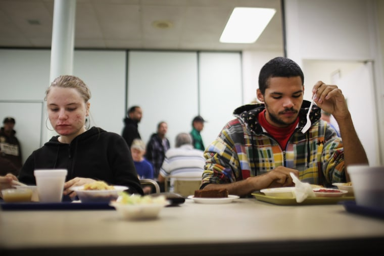 An out of work couple eats lunch at the Central Park United Methodist Church which has a soup kitchen and food pantry on October 20, 2011 in Reading, Pennsylvania.