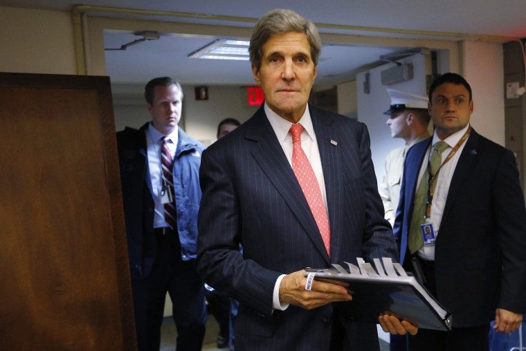 Secretary of State John Kerry enters the room for a news conference at the U.S. Embassy in Tel Aviv December 13, 2013.