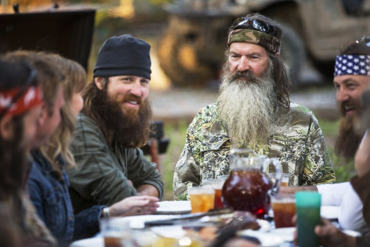 """Phil Robertson, flanked by his sons Jase and Willie, on the series \""""Duck Dynasty.\"""""""
