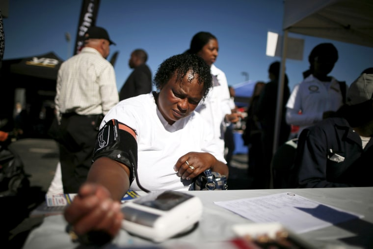Bernita Jackson, 51, has her blood pressure measured at an event to inform people about the Affordable Care Act in Los Angeles, Nov. 25, 2013.
