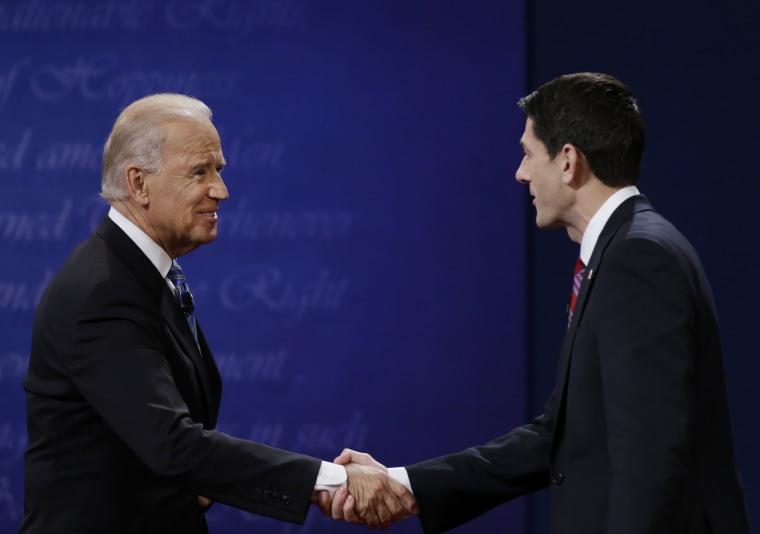 Vice President Joe Biden, left, and GOP VP nominee Rep. Paul Ryan shake hands following their the vice presidential debate at Centre College in Danville, Ky. (Photo: AP Photo/David Goldman)