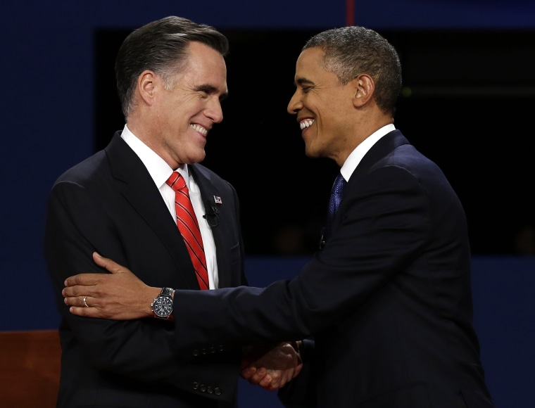 Republican presidential nominee Mitt Romney  and President Barack Obama shake hands during the first presidential debate at the University of Denver, Wednesday, Oct. 3, 2012, in Denver. (Photo: AP/Charlie Neibergall)