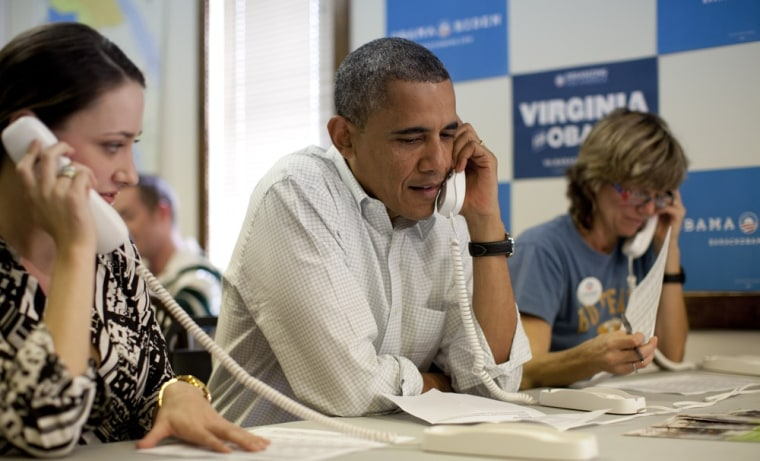 President Barack Obama makes phone calls to volunteers at an Organizing for America field office with Alexa Kissinger, left, and, Suzanne Stern, right,  Sunday, Oct. 14, 2012, in Williamsburg, Va.