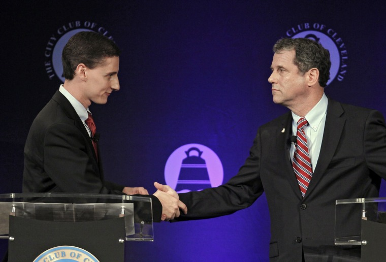 Democratic Ohio Sen. Sherrod Brown, right, shakes hands with Republican challenger and State Treasurer Josh Mandel, after their debate at the City Club in Cleveland on Monday, Oct. 15, 2012. (Photo: AP/Tony Dejak)
