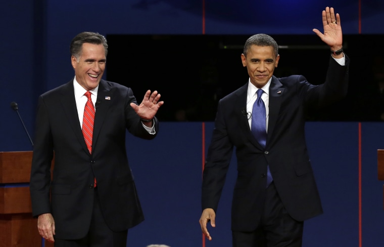 Republican presidential candidate Mitt Romney and President Barack Obama wave to the audience during the first presidential debate. (Photo: AP/Charlie Neibergall)