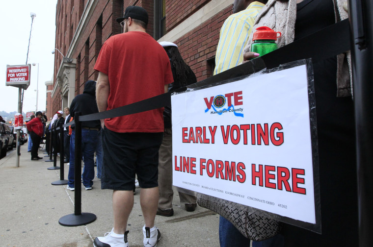 Voters stand in line outside the Hamilton County Board of Elections waiting to vote early in Ohio. Those voters will now be able to vote early on the three days before Election Day, thanks to the U.S. Supreme Court's refusal to block a lower court...