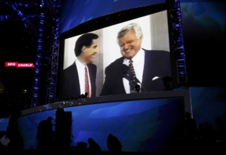 Mitt Romney, left, is pictured with late Sen. Ted Kennedy in a video segment during the first session of the DNC in Charlotte, N.C. (Photo: Jessica Rinaldi/Reuters)