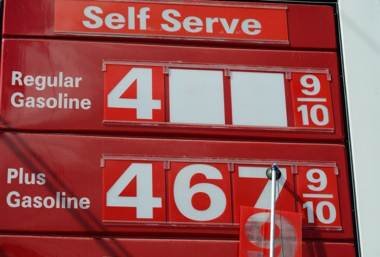 A gas station attendent changes gas prices on Oct. 10, in Los Angeles.  (Photo: Kevork Djansezian/Getty Images)