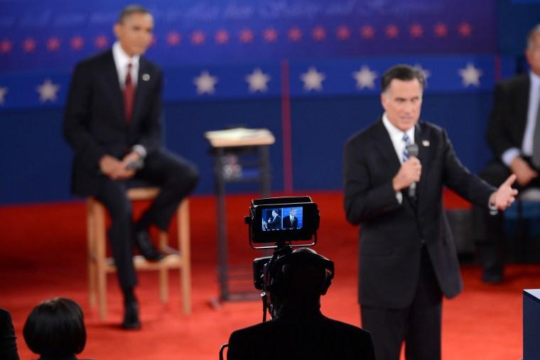President Obama looks on as Mitt Romney, speaks during the second presidential debate at Hofstra University in Hempstead, Long Island, NY. (Photo: AP/Anthony Behar/Sipa USA)