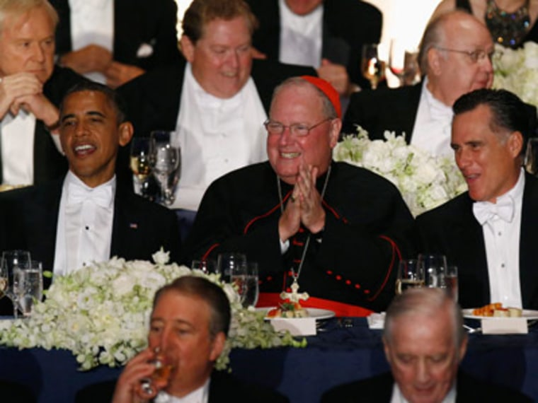 President Obama and Mitt Romney are pictured with Cardinal Timothy Dolan at the 67th Annual Alfred E. Smith Memorial Foundation dinner in New York on Thursday. (Jason Reed/Reuters)
