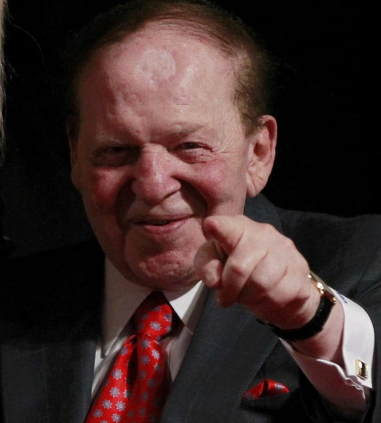 Chairman and CEO of the Las Vegas Sands casino Sheldon Adelson, a donor to Republican presidential nominee Mitt Romney, points to photographers at the end of the first presidential debate between Romney and President Barack Obama in Denver Oct. 3. ...