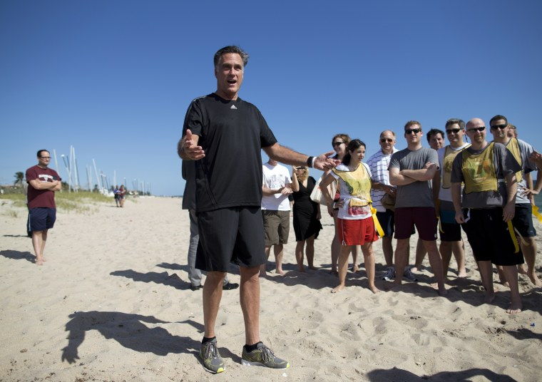Romney took a short break from debate preparations to do the opening coin toss for a flag football game between between reporters that cover Romney, and Romney staff on Sunday, Oct. 21, 2012 in Delray Beach, Fla. (AP Photo/ Evan Vucci)