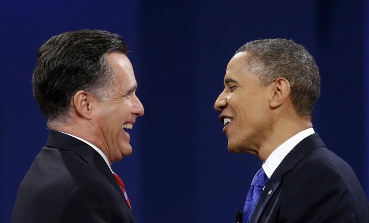 Republican president candidate former Massachusetts Gov. Mitt Romney and President Barack Obama meet at the end of the last debate at Lynn University, Monday, Oct. 22, 2012, in Boca Raton, Fla. (AP Photo/Pablo Martinez Monsivais)