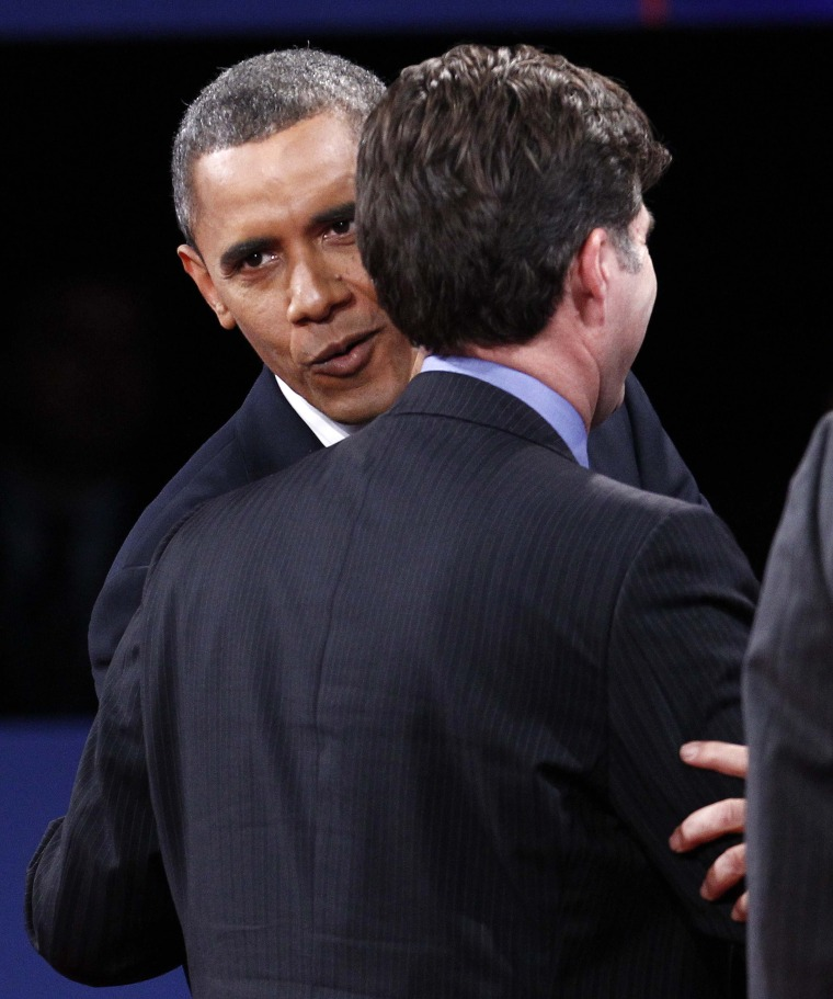 Forgive and forget? President Obama whispers into Tagg Romney's ear after the final presidential debate on Monday. (Photo: REUTERS/Jim Young)