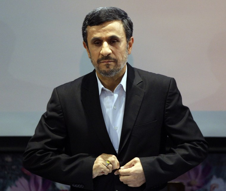 Iranian President Mahmoud Ahmadinejad listens to the Iranian national anthem at the start of a press conference in Tehran, Iran, Tuesday, Oct. 2, 2012.