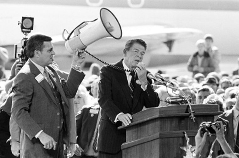 Republican presidential candidate Ronald Reagan lost his sound system at an airport rally in Texarkana, Arkansas on Oct. 30, 1980. Lynn Lowe, a Texarkana republican official, borrowed a bull horn from a high school band in attendance. (AP Photo/Ron...