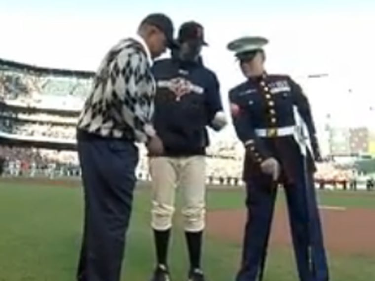 Marine Cpl. Nicholas Kimmel and former Giants outfielder Willie Mays before taking the mound at Game 2 of the MLB World Series (Photo: MLB)