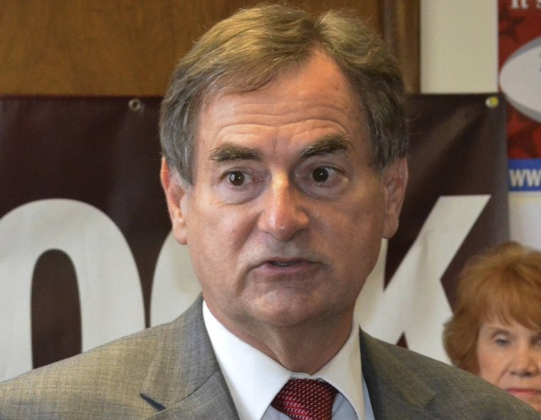 """Indiana Republican U.S. Senate candidate Richard Mourdock, speaks with volunteers at the Republican """"Victory Center"""" in Jeffersonville, Indiana in this October 3, 2012 file photograph. (Reuters)"""