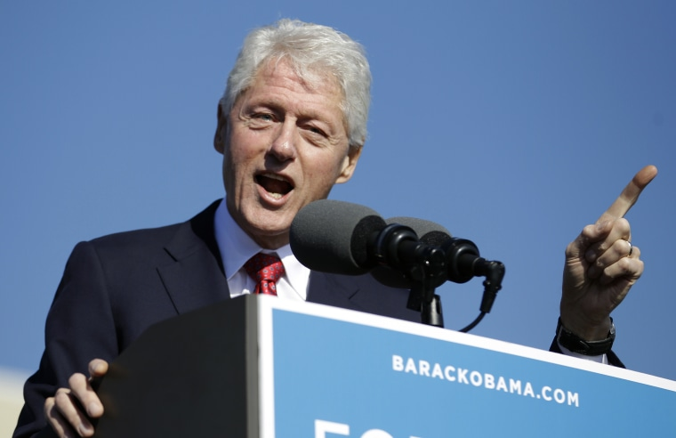 Former President Bill Clinton gestures while speaking at a campaign rally for President Barack Obama at the University of Central Florida, Monday, Oct. 29, 2012, in Orlando, Fla.  (AP Photo/John Raoux)