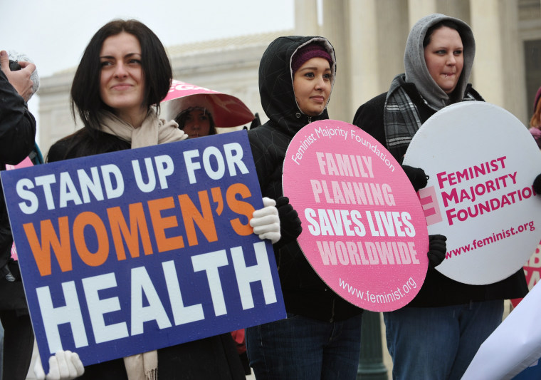 File photo: Pro-choice activists hold placards during a rally outside of the Supreme Court on January 23, 2012 in Washington, DC.  (Photo: Mandel Ngan/AFP Photo)