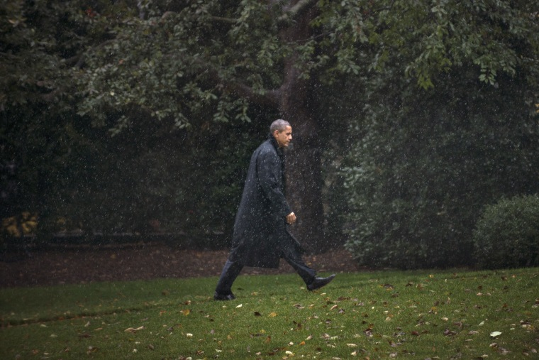 US President Barack Obama walks to the West Wing of the White House October 29, 2012 in Washington. Obama is returning from campaigning to monitor Hurricane Sandy as it makes landfall.  (AFP PHOTO/Brendan SMIALOWSKI)