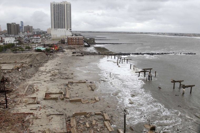 Foundations and pilings are all that remain of brick buildings and a boardwalk in Atlantic City, N.J., Tuesday, Oct. 30, 2012, after they were destroyed when a powerful storm that started out as Hurricane Sandy made landfall on the East Coast on Monday...