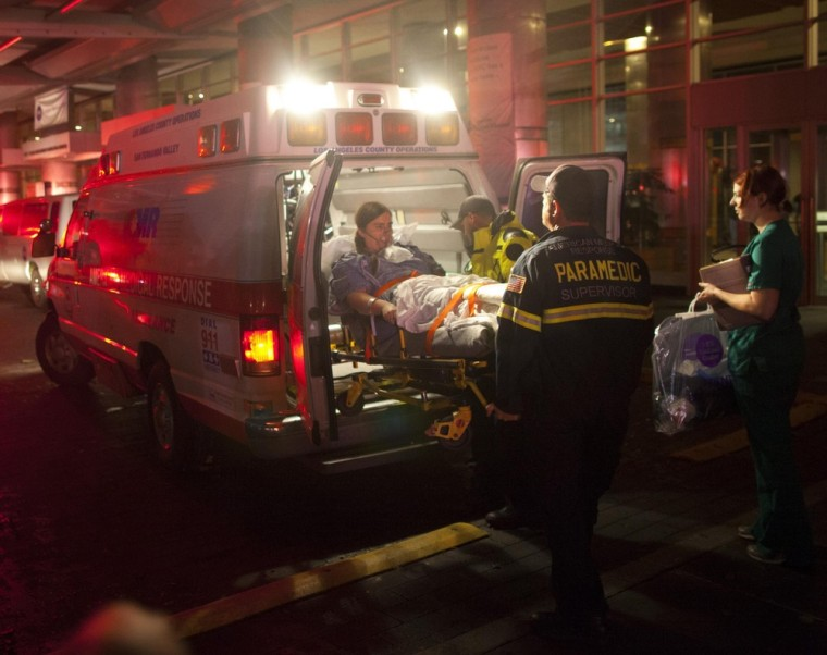 Paramedics evacuate patients from New York University Tisch Hospital due to a power outage as Hurricane Sandy makes its approach in New York October 29, 2012. (REUTERS/Andrew Kelly)