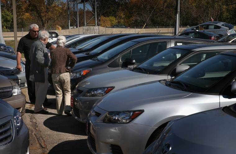 People look at cars at Northbrook Toyota on October 2, 2012 in Northbrook, Illinois. Toyota sales in September rose 42% from a year earlier. Chrysler had a 12% increase while Ford and General Motors sales were mostly flat (Photo: Getty Images/Scott Olson)