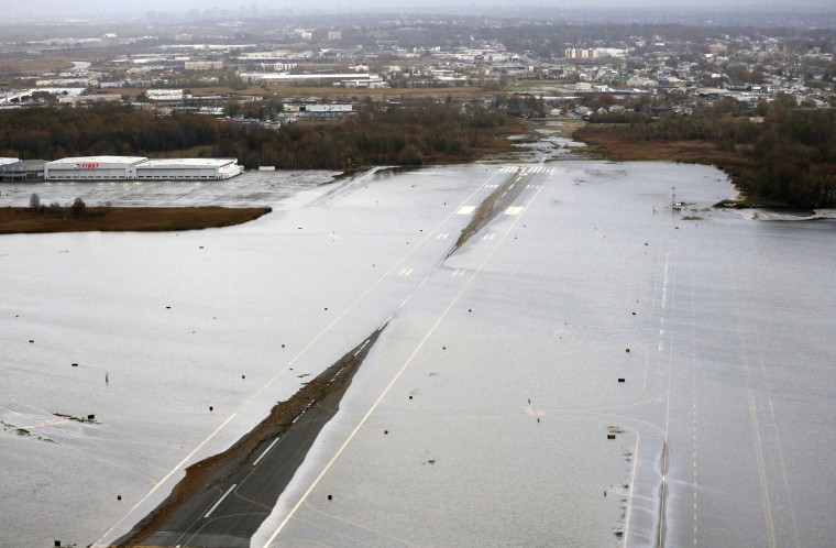 A runway at the Teterboro Airport is flooded in the wake of superstorm Sandy on Tuesday, Oct. 30, 2012, in New York. Sandy, the storm that made landfall Monday, caused multiple fatalities, halted mass transit and cut power to more than 6 million homes...