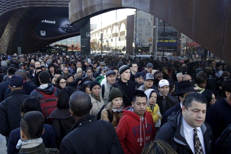 Brooklyn commuters wait in long, snaking line to board a shuttle to midtown Manhattan.