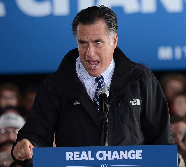 US Republican Presidential candidate Mitt Romney holds a rally at Dubuque regional airport in Dubuque, Iowa, (AFP PHOTO/Emmanuel Dunand)