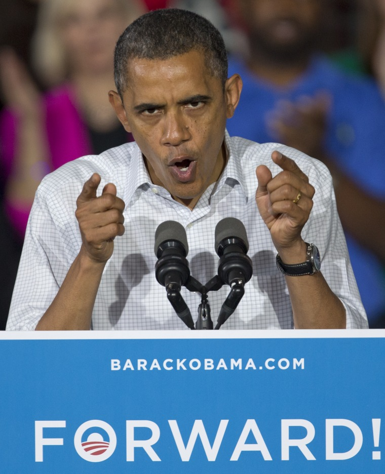 President Obama rallies the crowd at a campaign event at a high school in Mentor, Ohio.(AP Photo/Carolyn Kaster)