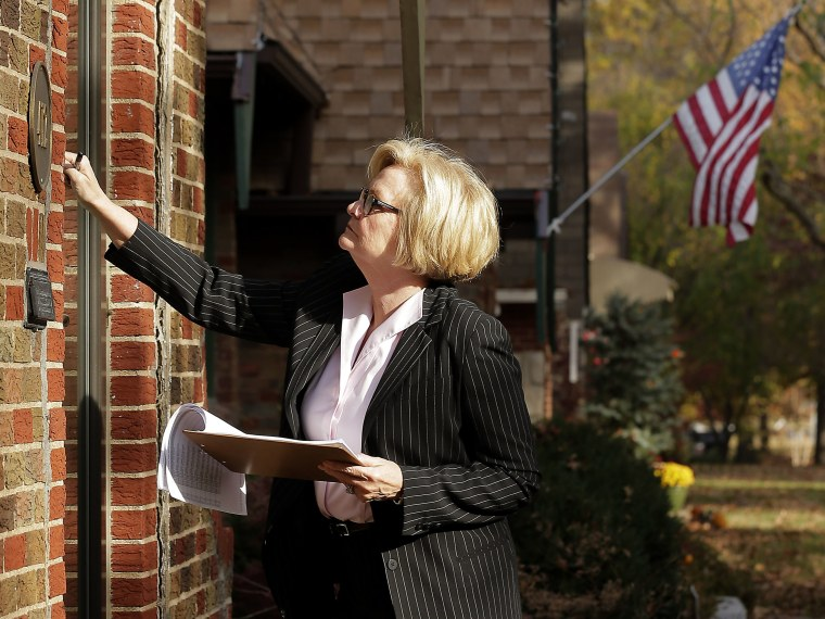 Democratic Sen. Claire McCaskill knocks on a door as she canvasses a neighborhood Friday, Nov. 2, 2012, in Kansas City, Mo. McCaskill is running against Republican Todd Akin for Missouri's Senate seat. (Photo by Charlie Riedel/AP Photo)