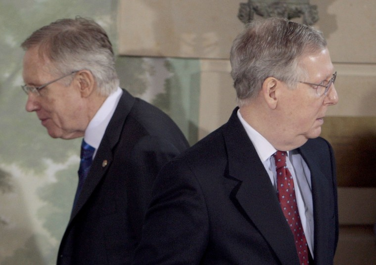 Senate Majority Leader Harry Reid of Nev., left, walks past Senate Minority Leader Mitch McConnell of Ky.  (Photo by Pablo Martinez Monsivais/AP)