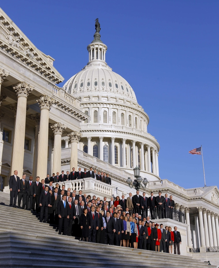 The freshmen class of House members of the upcoming 112th Congress, pose for a group photo on the steps that lead to the House of Representatives, on Capitol Hill in Washington, Friday, Nov. 19, 2010. (AP Photo/Alex Brandon)