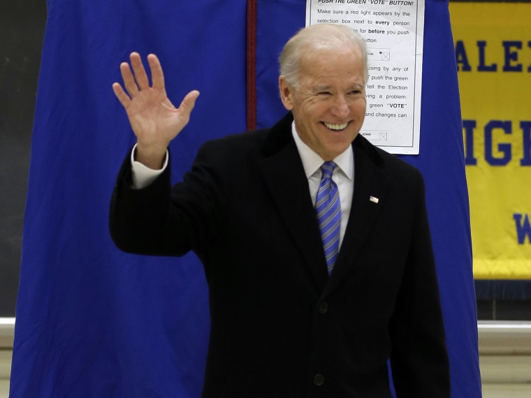Vice President Joe Biden waves as he exits a voting booth after casting his ballot at Alexis I. duPont High School, Tuesday, Nov. 6, 2012, in Greenville, Del. (Photo by AP Photo/Matt Rourke)