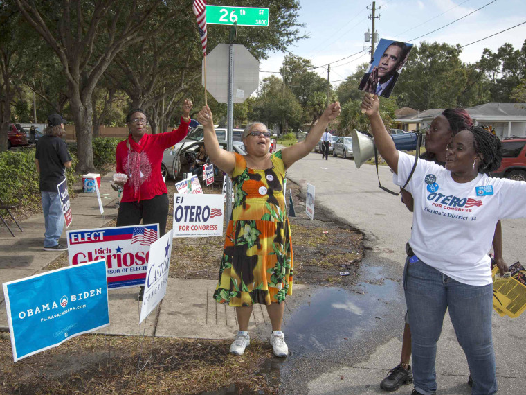 Supporter of President Barack Obama rally outside a polling station during the U.S. presidential election in Tampa, Florida November 6, 2012. (Photo by Scott Audette/Reuters)
