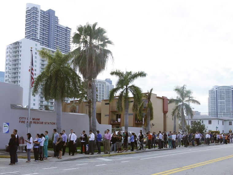 People wait in line to vote at a fire station near downtown, during the U.S. presidential election in Miami, Florida November 6, 2012. (Photo by REUTERS/Andrew Innerarity)