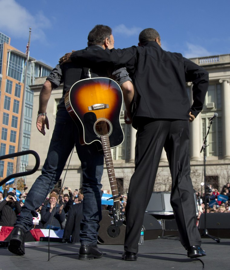 President Barack Obama and singer Bruce Springsteen stand together on stage during a campaign event, Monday, Nov. 5, 2012, in downtown Madison, Wis.  (AP Photo/Carolyn Kaster)