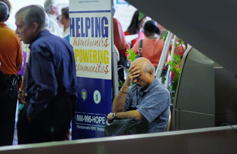 A man sits during a Help for Homeowners Community Event at the James L. Knight Center on February 22, 2012 in Miami, Florida. Preliminary exit polls signal that the economy was the number one factor for voters this election. (Photo by Joe Raedle/Getty...
