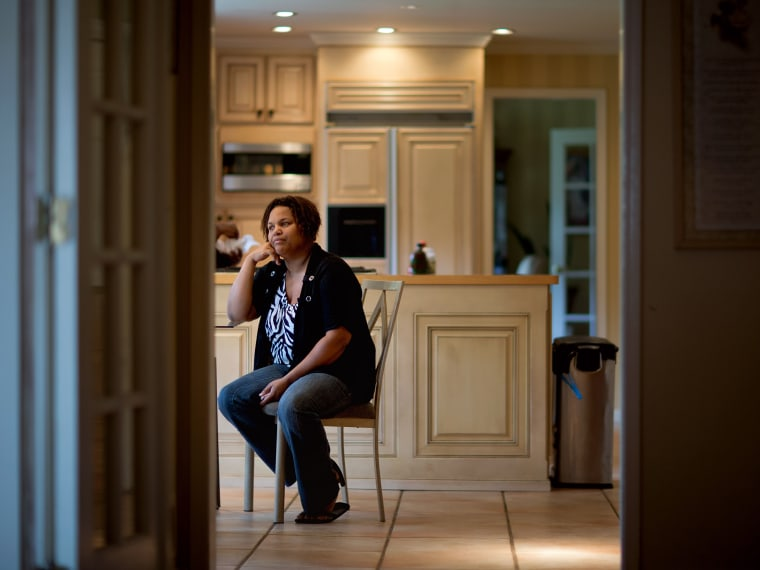 Yhonna Flowers sits inside the Georgia home she shares with her four children and her mother, retired Atlanta police Det. Jaqueline Barber in October. Less than a year after Occupy Atlanta members clashed with police in riot gear in a downtown park,...