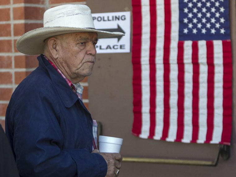 Jose Castrejon Olivares lines up to vote early Tuesday, Nov. 6, 2012 in Los Angeles. (Photo by AP Photo/Damian Dovarganes)