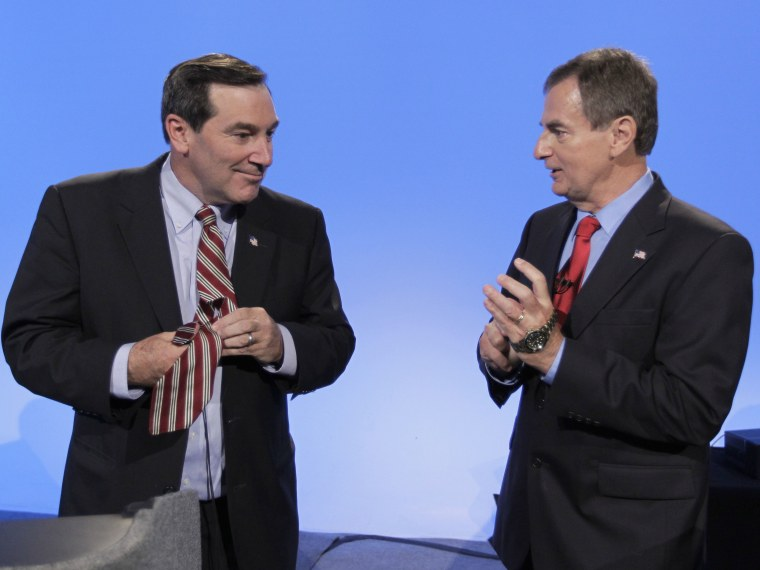 Democrat Joe Donnelly, left, and Republican Richard Mourdock talk after participating in a debate in Indianapolis, Monday, Oct. 15, 2012. (Photo by AP Photo/Michael Conroy)